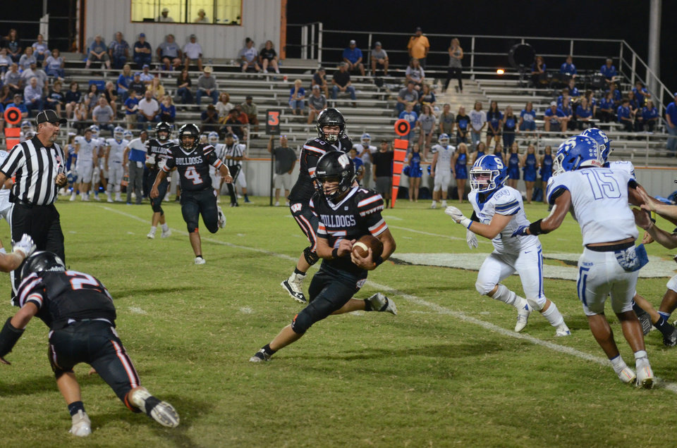 Photo - Wayne quarterback Ethan Mullins had 28 carries for 350 yards and six touchdowns in a 57-24 win at Konawa on Friday. [Photo courtesy of The Purcell Register]