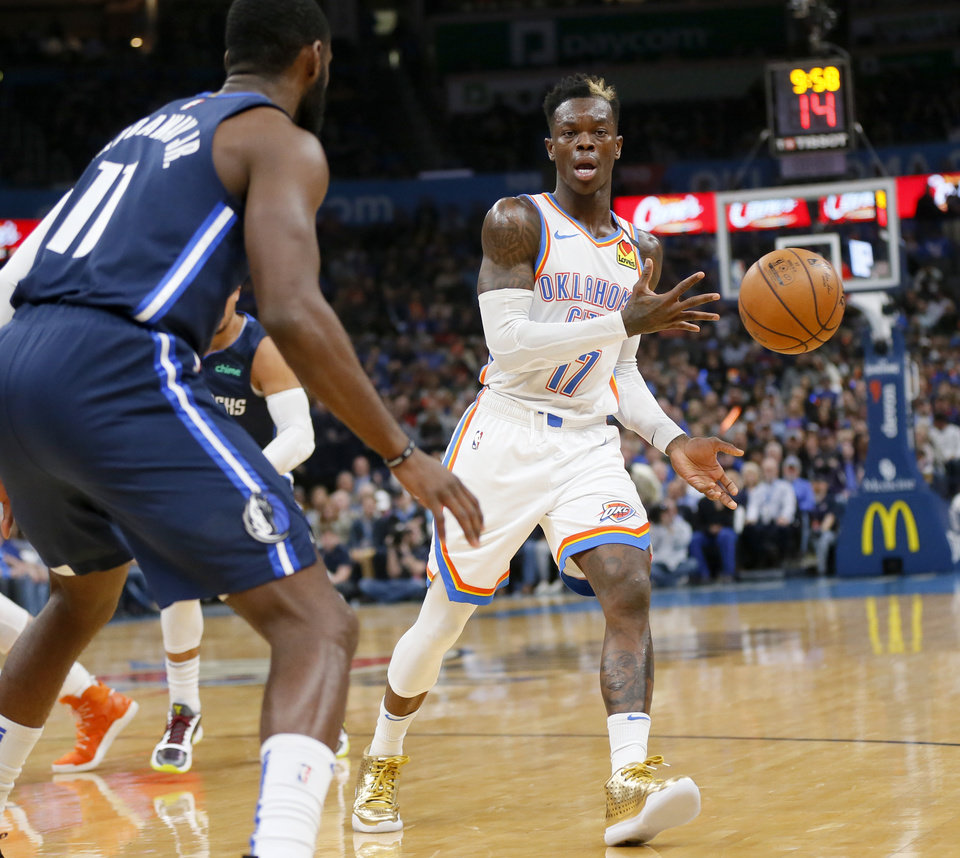 Photo - Oklahoma City's Dennis Schroder (17) passes away from Dallas' Tim Hardaway Jr. (11) in the second quarter during an NBA basketball game between the Oklahoma City Thunder and Dallas Mavericks at Chesapeake Energy Arena in Oklahoma City, Monday, Jan. 27, 2020. [Nate Billings/The Oklahoman]