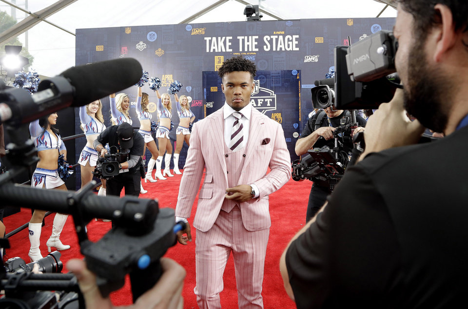 Photo - Oklahoma quarterback Kyler Murray walks the red carpet ahead of the first round at the NFL football draft, Thursday, April 25, 2019, in Nashville, Tenn. (AP Photo/Steve Helber)