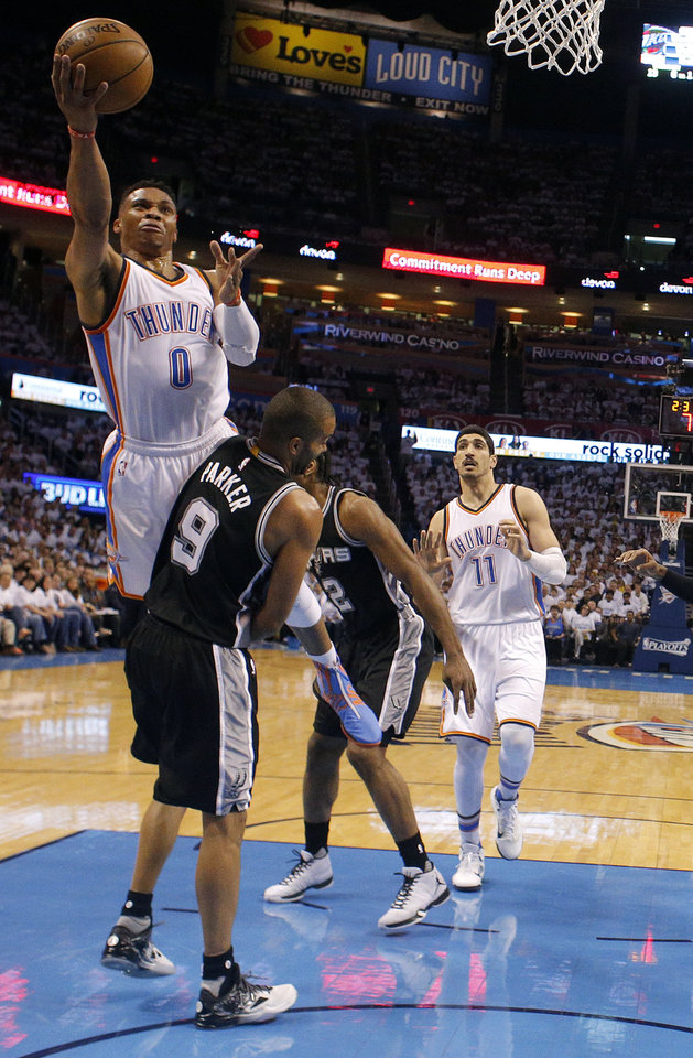 Photo - Oklahoma City's Russell Westbrook (0) shoots a lay up over San Antonio's Tony Parker (9) during Game 4 of the Western Conference semifinals between the Oklahoma City Thunder and the San Antonio Spurs in the NBA playoffs at Chesapeake Energy Arena in Oklahoma City, Sunday, May 8, 2016. Photo by Sarah Phipps, The Oklahoman