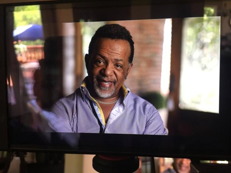 Photo -  Bishop Carlton Pearson, an affiliate minister at Tulsa's All Souls Unitarian Church, is seen through a camera monitor during the filming of the documentary