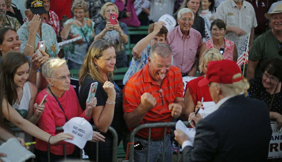 Photo - Republican presidential candidate Donald Trump greets supporters after a rally at the Oklahoma State Fair in Oklahoma City, Friday, September 25, 2015. Photo by Bryan Terry, The Oklahoman