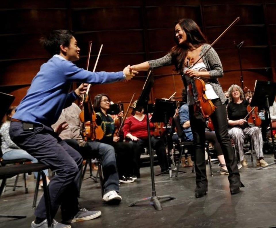 Photo -  Oklahoma City Philharmonic Orchestra concertmaster Gregory Lee, left, meets with visiting violinist Chee-Yun in 2018 during rehearsals in Oklahoma City.  [The Oklahoman Archives]