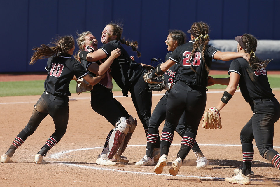 Photo - Tuttle celebrates after wining the Class 4A state softball championship game between Tuttle and Lone Grove at USA Softball Hall of Fame Stadium in Oklahoma City, Saturday, Oct. 17, 2020. [Bryan Terry/The Oklahoman]