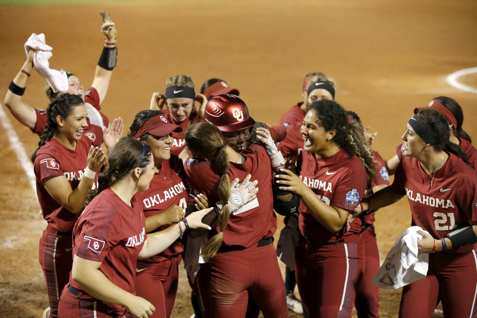 Photo - Oklahoma's Shay Knighten (17) celebrates with teammates after hitting a home run in the seventh inning of the second NCAA softball game in the championship series of the Women's College World Series between Oklahoma and UCLA at USA Softball Hall of Fame Stadium in Oklahoma City, Tuesday, June 4, 2019. UCLA won 5-4. [Bryan Terry/The Oklahoman]