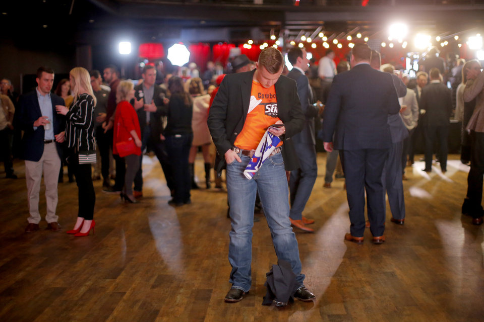 Photo - Taylor Stephens an Oklahoma State University student from Claremore, Okla., checks election results during the Republican election night watch party for the 2018 elections at the Bricktown Events Center in Oklahoma City, Nov. 6, 2018. Photo by Bryan Terry, The Oklahoman