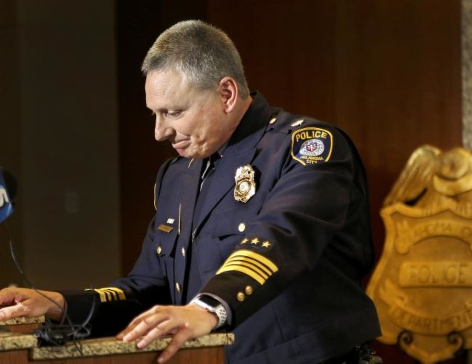 Photo -  Wade Gourley pauses to regain his composure as he wraps up remarks following his appointment Monday as Oklahoma City's new police chief. [Jim Beckel/The Oklahoman]