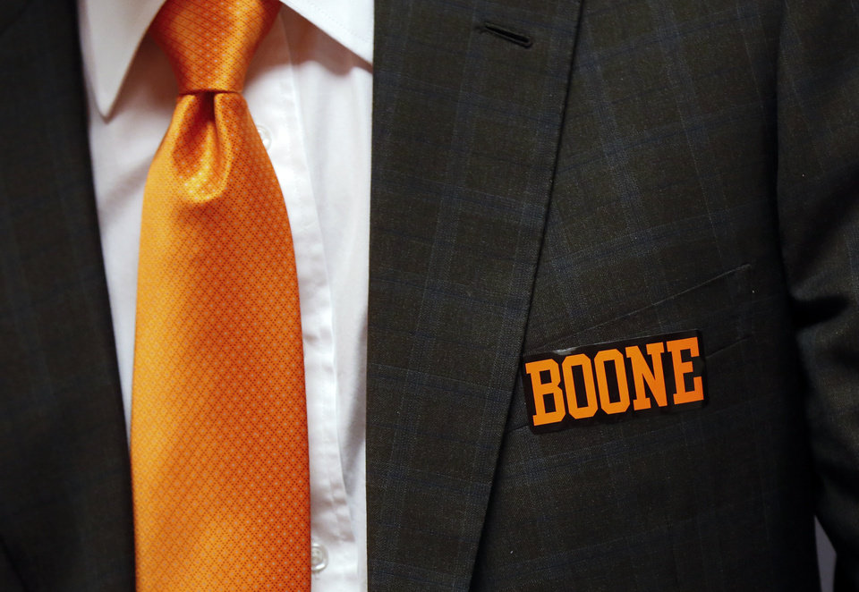 "Photo - Oklahoma State athletic director Mike Holder wears a ""Boone"" sticker on his jacket as he talks to the media before the Celebration of Life for OSU alumnus and benefactor Boone Pickens at Gallagher-Iba Arena in Stillwater, Okla., Wednesday, Sept. 25, 2019. [Nate Billings/The Oklahoman]"