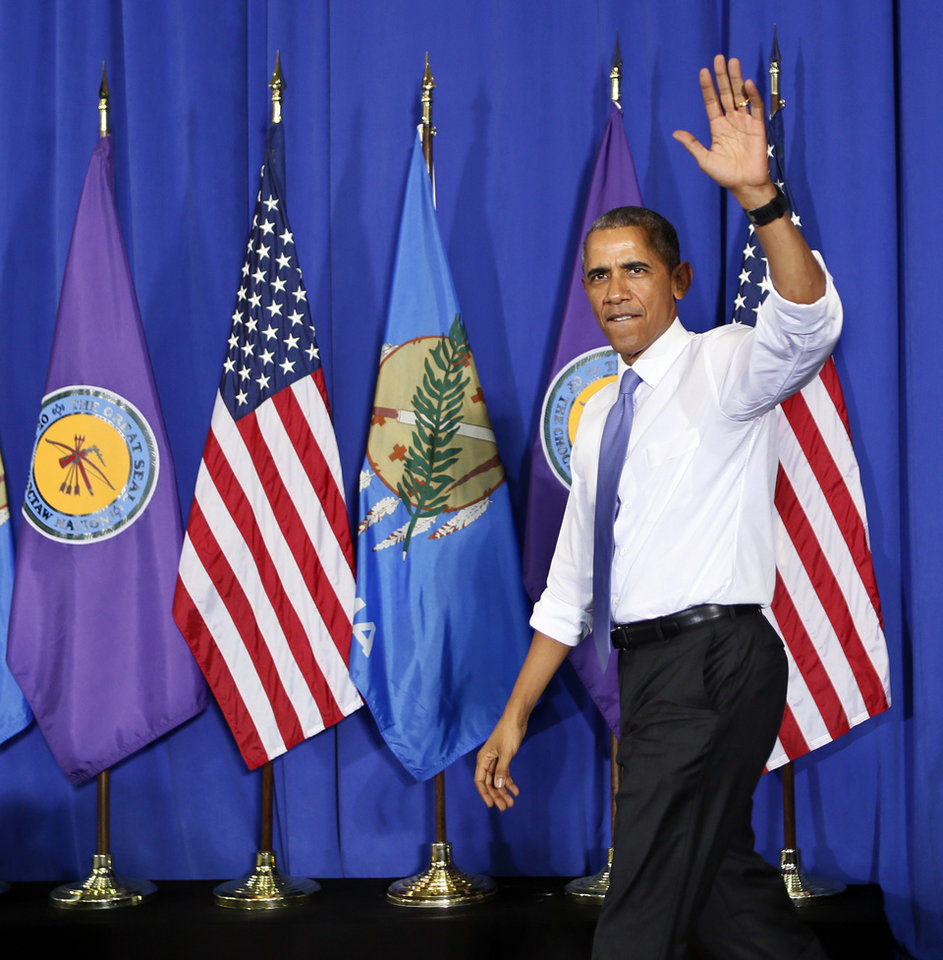 Photo - President Barack Obama waves as he walks on stage to give a speech at Durant High School in Durant, Okla., Wednesday, July 15, 2015. Photo by Nate Billings, The Oklahoman