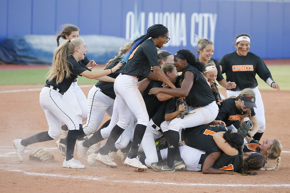 Photo - Coweta celebrates after winning the Class 5A state softball championship game between Coweta and Carl Albert at USA Softball Hall of Fame Stadium in Oklahoma City, Saturday, Oct. 17, 2020. [Bryan Terry/The Oklahoman]