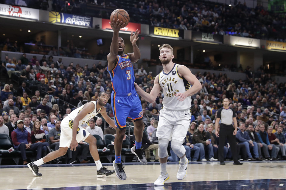 Photo - Oklahoma City Thunder guard Chris Paul (3) shoots next to Indiana Pacers forward Domantas Sabonis (11) during the first half of an NBA basketball game in Indianapolis, Tuesday, Nov. 12, 2019. (AP Photo/Michael Conroy)