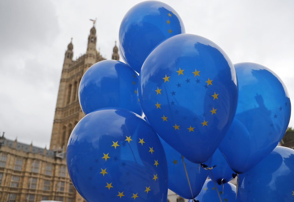 Photo -  A Pro EU protestor holds balloons opposite parliament in London, Monday, Sept. 9, 2019. British Prime Minister Boris Johnson voiced optimism Monday that a new Brexit deal can be reached so Britain leaves the European Union by Oct. 31.(AP Photo/Frank Augstein)
