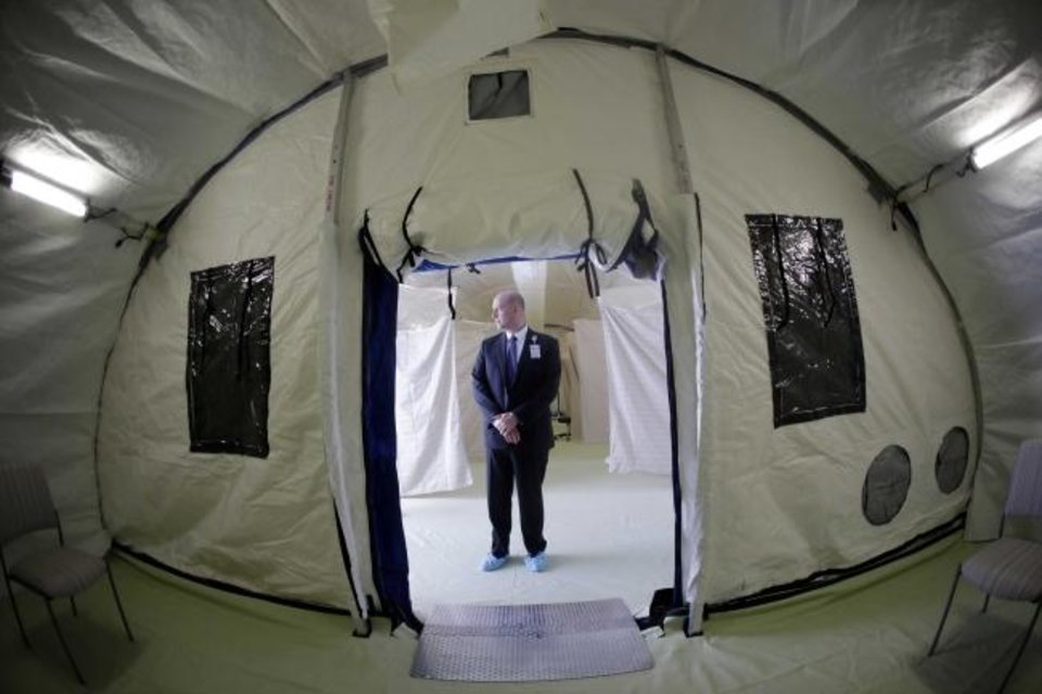 Photo -  Philip Chaffee, senior director emergency management stands in a negative pressure tent outside the University of Utah's hospital, Monday in Salt Lake City. The hospital is taking steps to limit the spread of the new coronavirus, including new visitor policies and the construction of outdoor negative pressure tents where people can be tested without having to go inside the hospital building.
