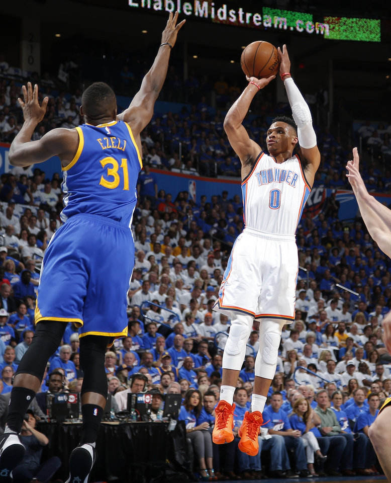 Photo - Oklahoma City's Russell Westbrook (0) shoots over Golden State's Festus Ezeli (31) during Game 3 of the Western Conference finals in the NBA playoffs between the Oklahoma City Thunder and the Golden State Warriors at Chesapeake Energy Arena in Oklahoma City, Sunday, May 22, 2016. Photo by Bryan Terry, The Oklahoman