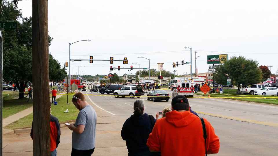 Photo - The scene of a fatal crash at the intersection of Main and Hall of Fame during the Oklahoma State University (OSU) homecoming parade in Stillwater, Okla., Saturday, Oct. 24, 2015. Photo by Zachary Green, For The Oklahoman
