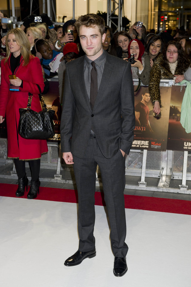 Photo - British actor Robert Pattinson arrives for the UK premiere of 'Twilight Breaking Dawn Part 1' at a central London venue,  Wednesday, Nov. 16, 2011. (AP Photo/Jonathan Short) ORG XMIT: LJS106