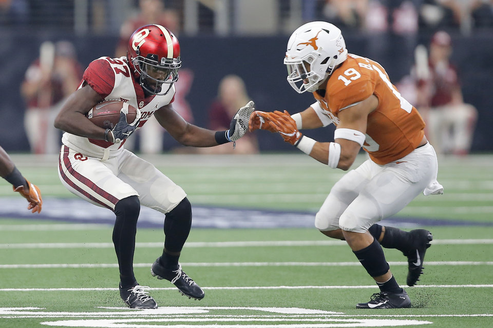 Photo - Oklahoma's Myles Tease (87) tries to get past Brandon Jones (19) of Texas during the Big 12 Championship football game between the Oklahoma Sooners (OU) and the Texas Longhorns (UT) at AT&T Stadium in Arlington, Texas, Saturday, Dec. 1, 2018.  Oklahoma won 39-27. Photo by Bryan Terry, The Oklahoman