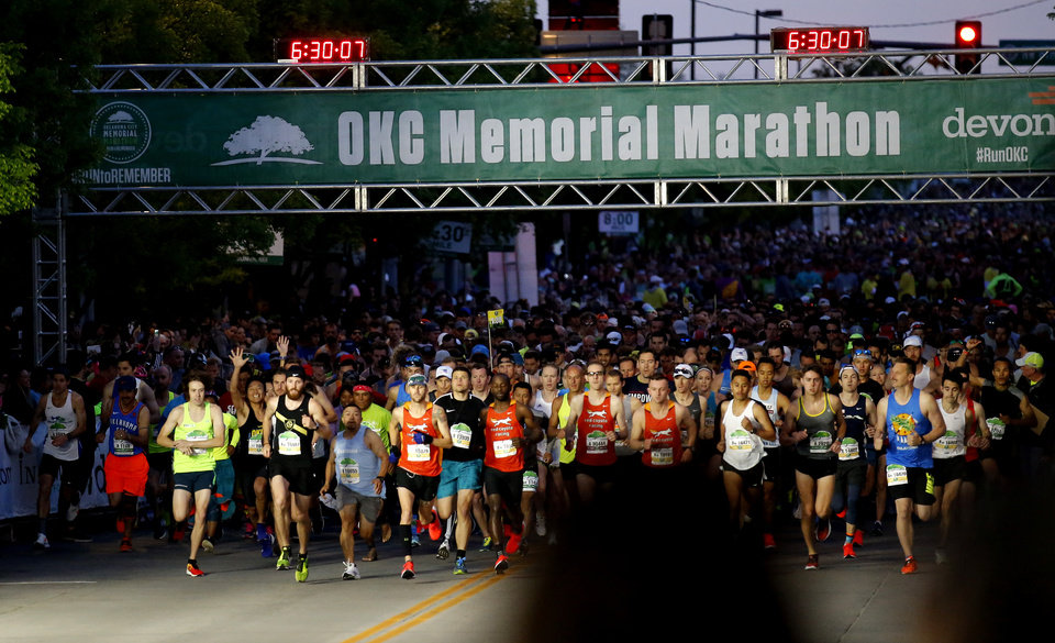 Photo - Runs start the Oklahoma City Memorial Marathon in Oklahoma City, Sunday, April 28, 2019. [Sarah Phipps/The Oklahoman]