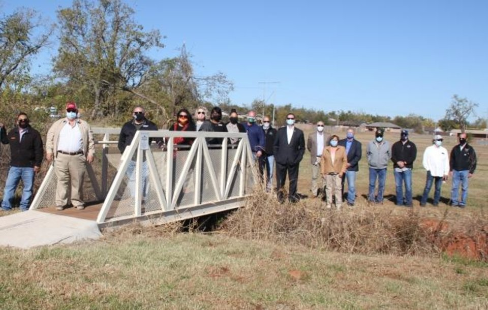 Photo -  A new footbridge built across a ravine will benefit schoolchildren walking to and from Bodine Elementary School. The project was completed with volunteer work and donated supplies. [PHOTO PROVIDED]