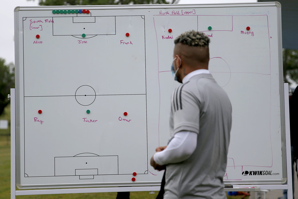 Photo - Frank Lopes with OKC Energy FC looks at a board as he arrives for soccer practice in Oklahoma City, Wednesday, May 13, 2020. [Bryan Terry/The Oklahoman]