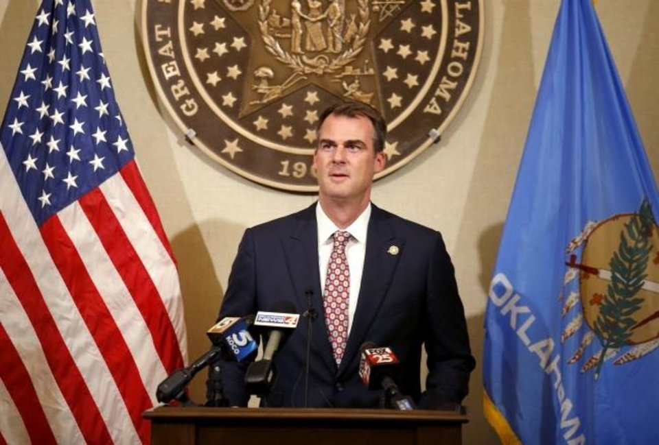 Photo -  Gov. Kevin Stitt is pictured speaking at a news conference. Photo by Sarah Phipps, The Oklahoman
