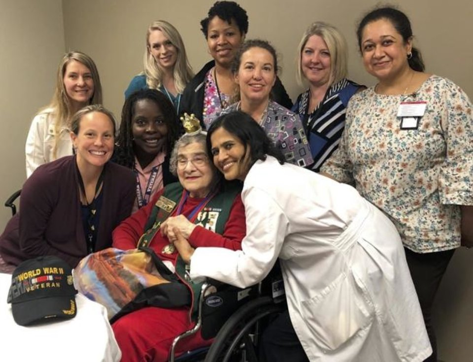 Photo -  Oklahoma City VA Healthcare System Women's Clinic team surrounds Mary Glann during her birthday celebration. [PHOTO PROVIDED]