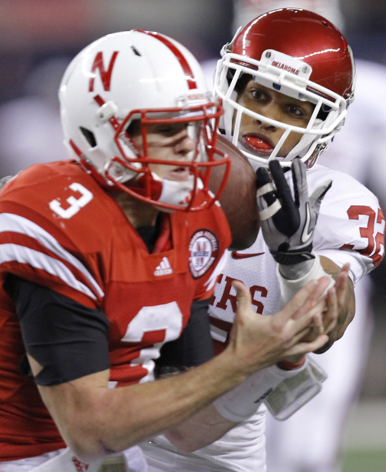 Photo - Oklahoma's Jamell Fleming (32) has a interception broken up by Nebraska's Taylor Martinez (3) during the Big 12 football championship game between the University of Oklahoma Sooners (OU) and the University of Nebraska Cornhuskers (NU) at Cowboys Stadium on Saturday, Dec. 4, 2010, in Arlington, Texas.  Photo by Chris Landsberger, The Oklahoman