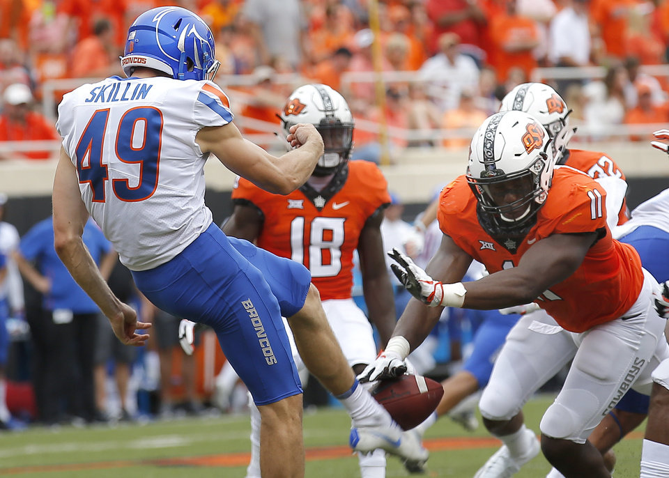 Photo -  Oklahoma State's Amen Ogbongbemiga (11) blocks the punt of Boise State's Quinn Skillin (49) in the second quarter Saturday's game with the Boise State Broncos at Boone Pickens Stadium in Stillwater. [Photo by Sarah Phipps, The Oklahoman]