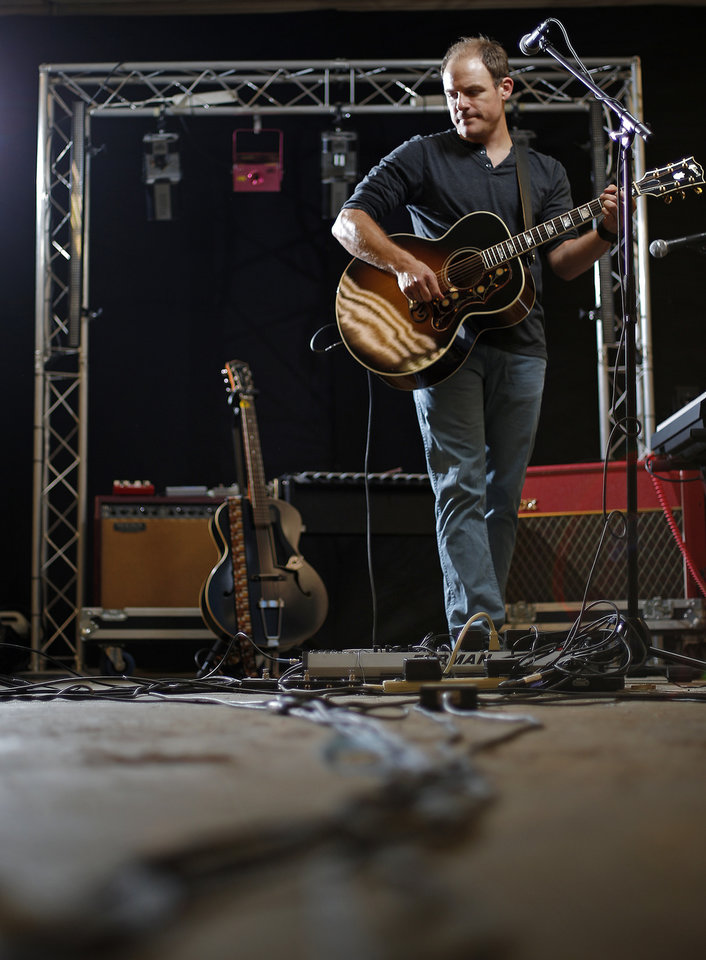Photo -  Musician Brantley Cowan, who has recovered from a broken back, is photographed inside rehearsal space in Oklahoma City in 2014. [Photo by Bryan Terry, The Oklahoman Archive]