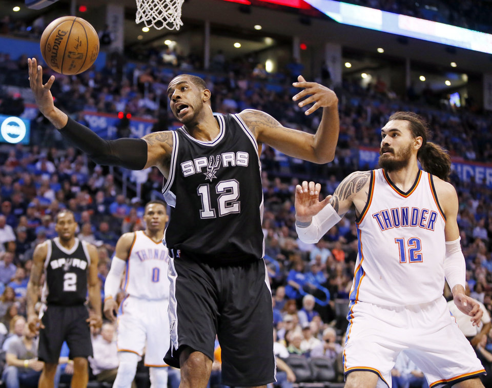 Photo - San Antonio's LaMarcus Aldridge (12) grabs a pass next to Oklahoma City's Steven Adams (12) during an NBA basketball game between the Oklahoma City Thunder and San Antonio Spurs at Chesapeake Energy Arena in Oklahoma City, Friday, March 31, 2017. Photo by Nate Billings, The Oklahoman