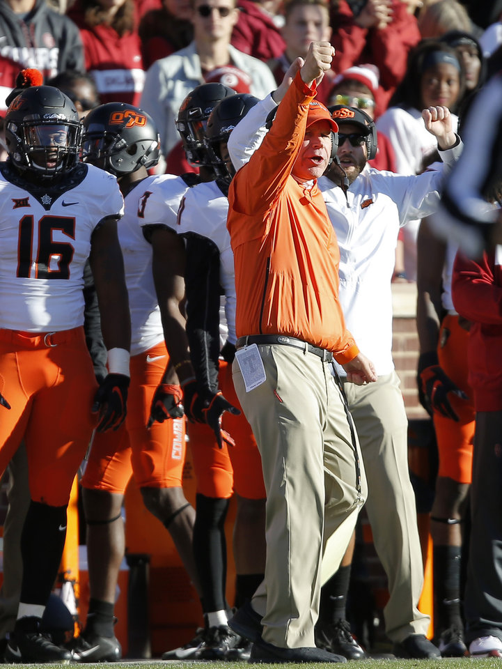 Photo - Oklahoma State defensive coordinator Jim Knowles gestures during a Bedlam college football game between the University of Oklahoma Sooners (OU) and the Oklahoma State University Cowboys (OSU) at Gaylord Family-Oklahoma Memorial Stadium in Norman, Okla., Nov. 10, 2018.  Photo by Bryan Terry, The Oklahoman