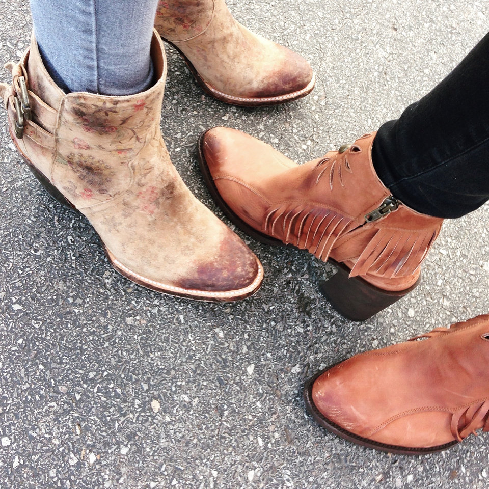 Photo - Left:  Vintage inspired floral bootie by Lucchese.  Soft and romantic with an edge, this statement boot is a fall favorite!     Right: Boho chic bootie with open heel and fringe embellishments by Old Gringo.