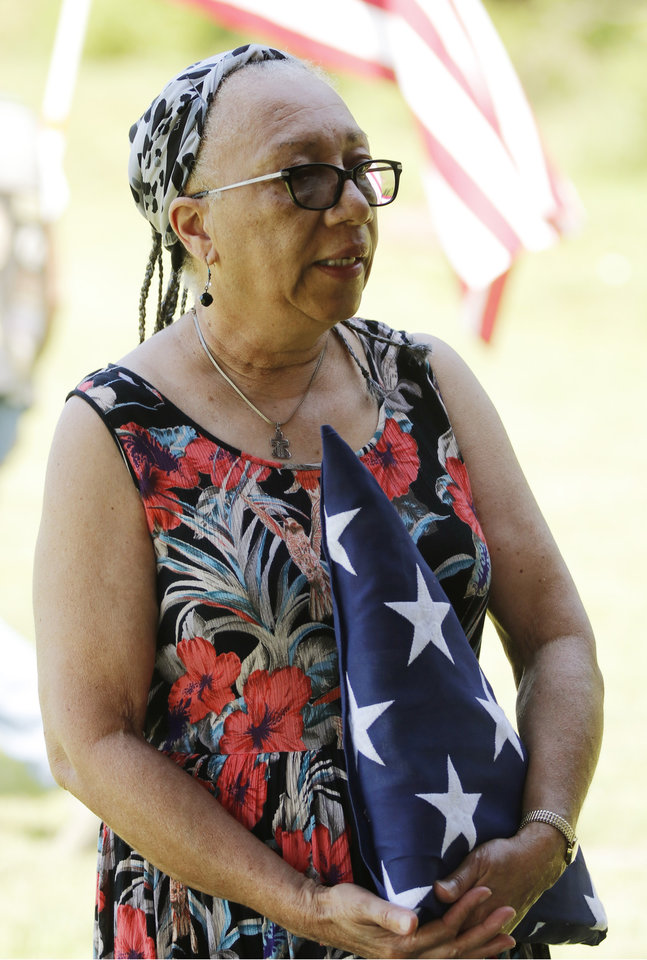 Photo - Alma Lucas, granddaughter of Ulysses Grant Moore at the memorial for U.G. Moore, a WWI vet whose grave marker never make it to his grave at Trice Hill Cemetery, until 55 years after his death, Tuesday, July 16, 2019. [Doug Hoke/The Oklahoman]