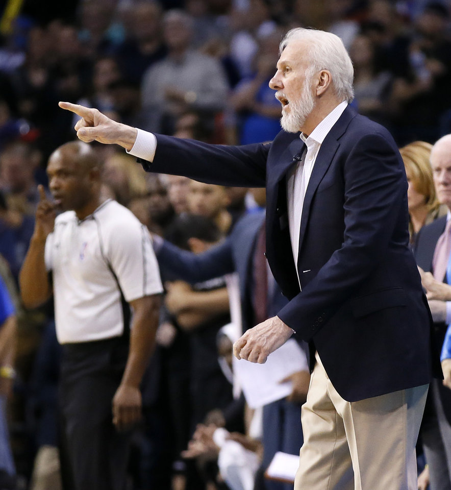 Photo - San Antonio coach Gregg Popovich gives instructions to his team during an NBA basketball game between the Oklahoma City Thunder and San Antonio Spurs at Chesapeake Energy Arena in Oklahoma City, Friday, March 31, 2017. San Antonio won 100-95. Photo by Nate Billings, The Oklahoman