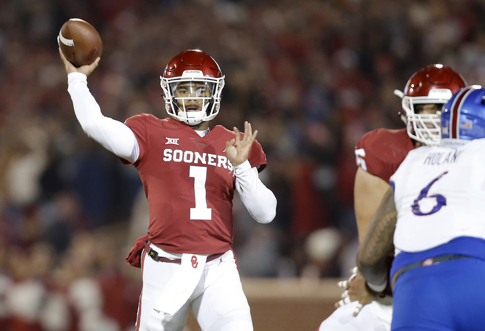 Photo - Oklahoma's Kyler Murray (1) throws a pass during a college football game between the University of Oklahoma Sooners (OU) and the Kansas Jayhawks (KU) at Gaylord Family-Oklahoma Memorial Stadium in Norman, Okla., Saturday, Nov. 17, 2018. Photo by Bryan Terry, The Oklahoman