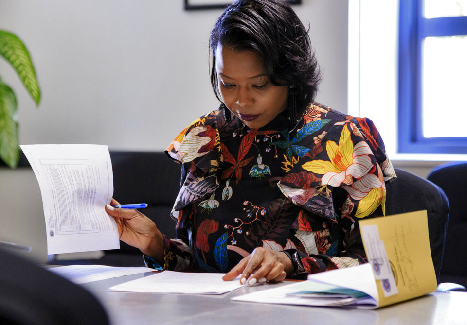Photo - New Oklahoma City Ward 7 councilwoman Nikki Nice goes over paper work as she begins her new position on the city council at the City of Oklahoma City's City Council office in Oklahoma City, Okla. on Friday, Nov. 9, 2018. Photo by Chris Landsberger, The Oklahoman
