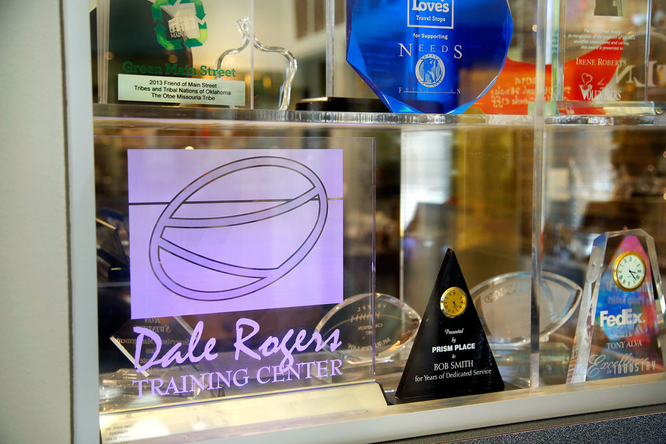 Photo -  An array of acrylic and other awards manufactured by Dale Rogers Training Center clients are displayed in the windows of the center's Prism Place. [PHOTO BY JIM BECKEL, THE OKLAHOMAN]