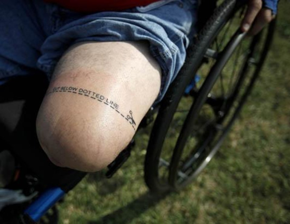 Photo -  Dave Nelson of Omaha, Neb., shows his tattoo he got before traveling to Oklahoma for his first Endeavor Games at Edmond North High School in Edmond, Okla., Sunday, June 14, 2009. Photo by Sarah Phipps, The Oklahoman
