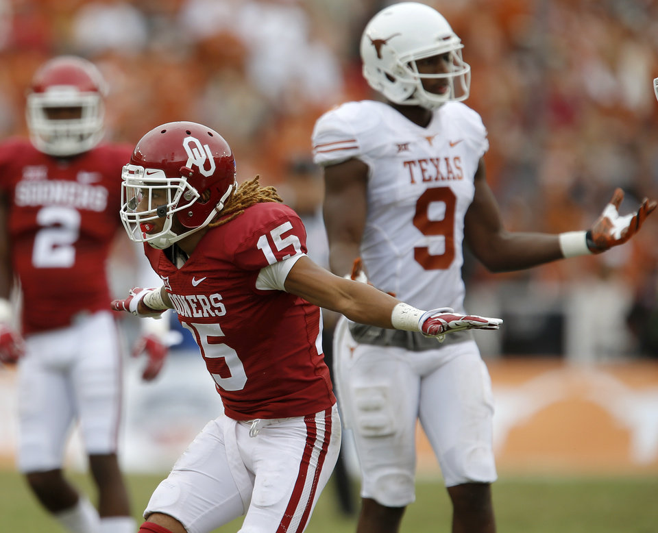Photo - Oklahoma's Zack Sanchez (15) celebrates in front of Texas' John Harris (9) after an incomplete pass during the Red River Showdown college football game between the University of Oklahoma Sooners (OU) and the University of Texas Longhorns (UT) at the Cotton Bowl in Dallas on Saturday, Oct. 11, 2014. 