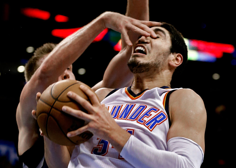 Photo - Oklahoma City's Enes Kanter (34) is fouled by Minnesota's Justin Hamilton (41) as the Oklahoma City Thunder play the Minnesota Timberwolves in NBA basketball at the Chesapeake Energy Arena in Oklahoma City, on Friday, March 13, 2015.  Photo by Steve Sisney, The Oklahoman