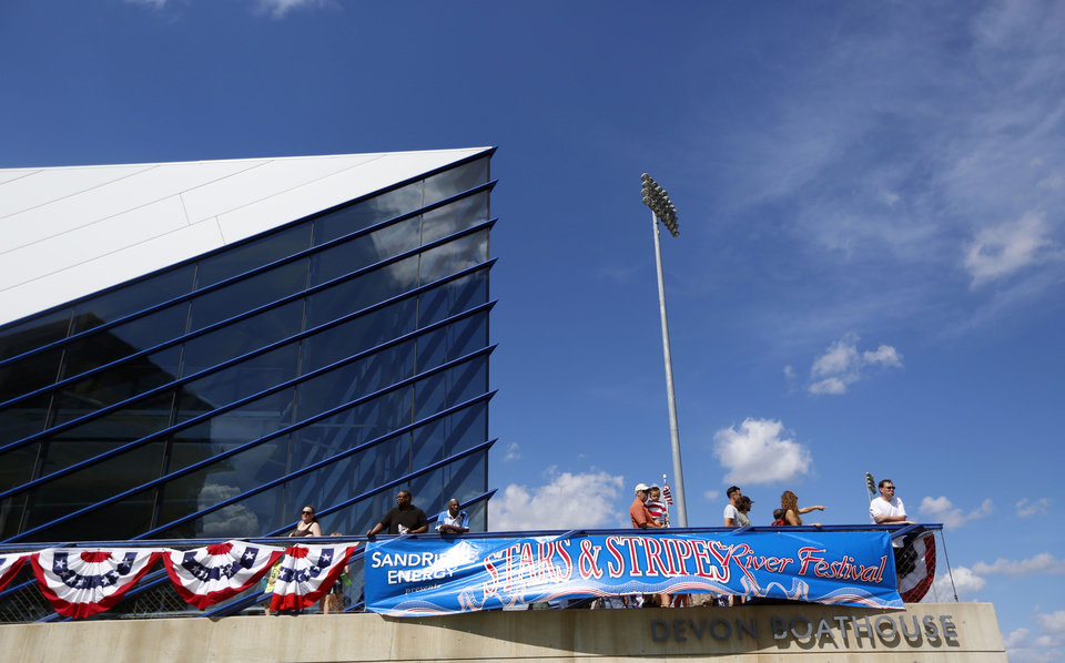 Photo -  People watch dragon boat races during the 2015 Stars and Stripes River Festival on the Oklahoma River. [Photos by Sarah Phipps, The Oklahoman Archives]