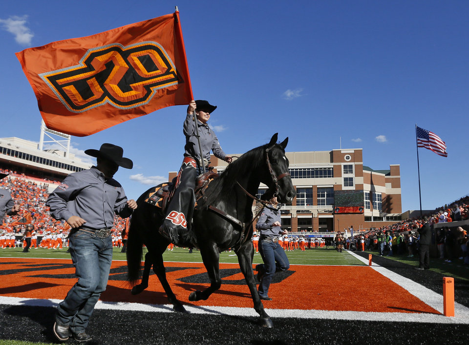 Photo - Bullet and the Spirit Rider during pre-game activities before the college football game between the Oklahoma State Cowboys (OSU) and TCU Horned Frogs at Boone Pickens Stadium in Stillwater, Okla., Saturday, Nov. 7, 2015. Photo by Nate Billings, The Oklahoman