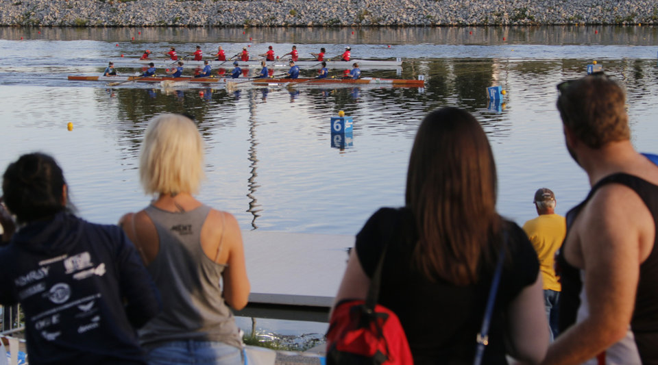 Photo -  Spectators watch the first 1,000 meter heat on Friday of the Oklahoma Regatta at the Oklahoma River. [Photo by Doug Hoke, The Oklahoman]