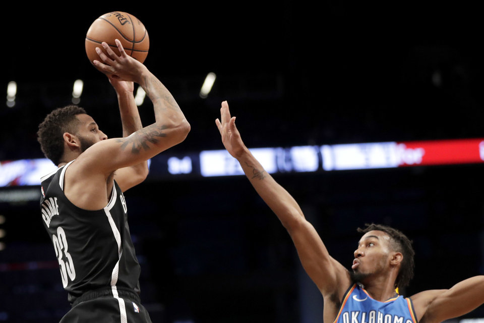 5ba21ddf6 Brooklyn Nets guard Allen Crabbe goes up for a shot against Oklahoma City  Thunder guard Terrance Ferguson during the second half of an NBA basketball  game
