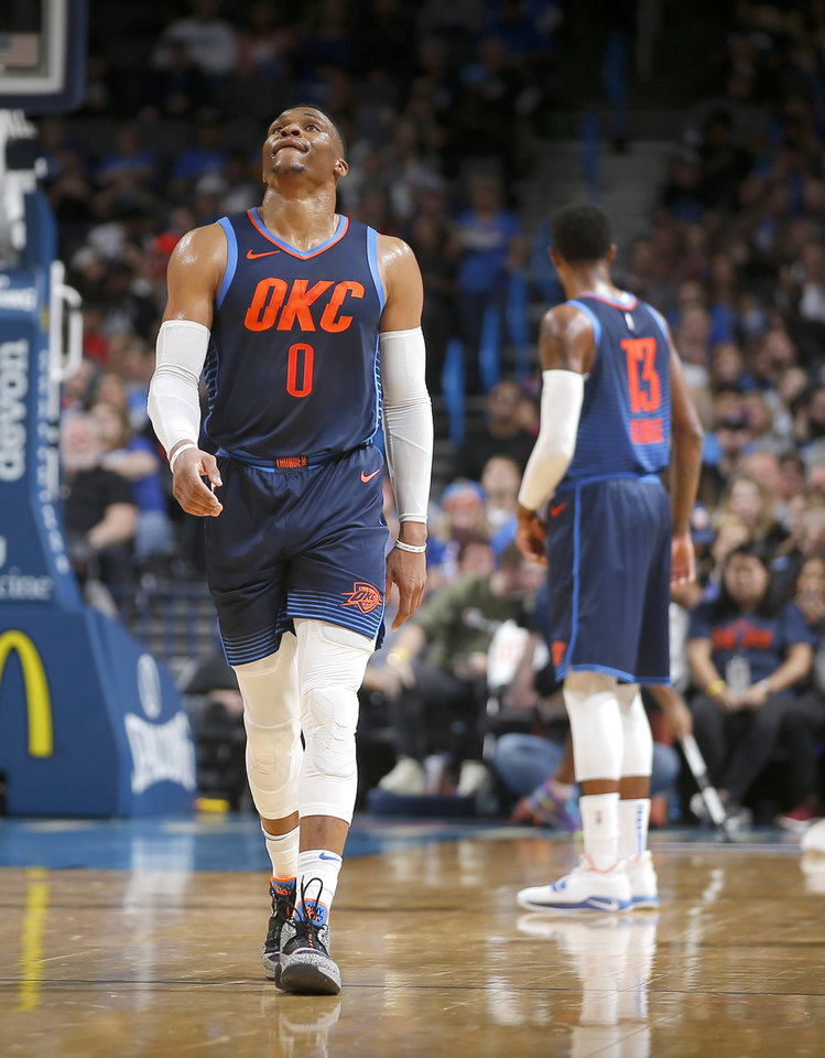 Photo - Oklahoma City's Russell Westbrook (0) looks towards the scoreboard during an NBA basketball game between the Oklahoma City Thunder and the Sacramento Kings at Chesapeake Energy Arena in Oklahoma City, Sunday, Oct. 21, 2018. Photo by Bryan Terry, The Oklahoman