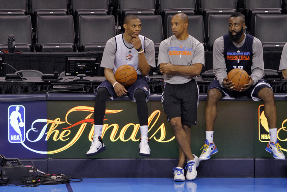 Photo - Oklahoma City's Russell Westbrook and James Harden talk with head athletic trainer Joe Sharpe during the NBA Finals practice day at the Chesapeake Energy Arena on Monday, June 11, 2012, in Oklahoma City, Okla. Photo by Chris Landsberger, The Oklahoman