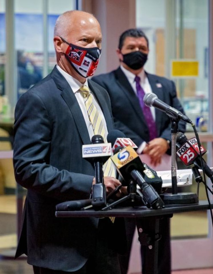 Photo -  Oklahoma Commissioner of Health Lance Frye speaks during a press conference to discuss details of the voluntary in-school quarantine policy at Mustang High School in Mustang on Wednesday.  [Chris Landsberger/The Oklahoman]
