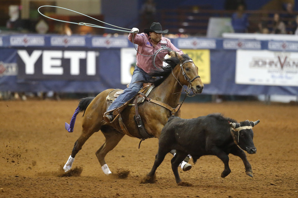 Photo - Marcus Theriot of Poplarville, Mississippi, competes in the heading event during the Timed Event Championship inside the Lazy E Arena in Guthrie, Okla., Friday, March 13, 2020. [Bryan Terry/The Oklahoman]