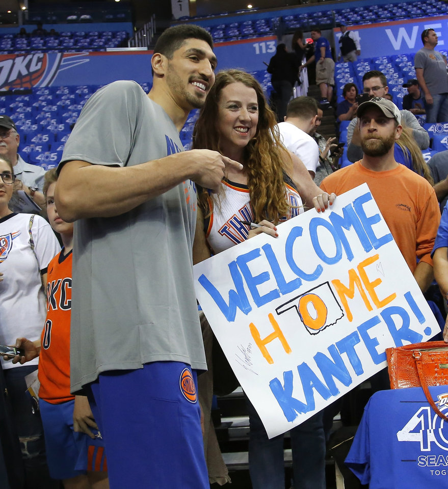 Photo -  Enes Kanter poses for a photo with a fan when he returned as a member of the New York Knicks in 2017. Kanter, who now plays for Boston, plans to open a charter school in Oklahoma City. [Bryan Terry, The Oklahoman Archives]