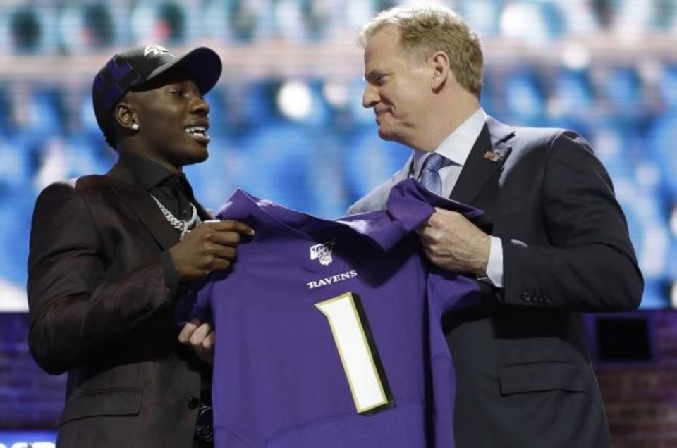 Photo -  Oklahoma wide receiver Marquise Brown poses with NFL Commissioner Roger Goodell after the Baltimore Ravens Brown selected in the first round Thursday. [AP Photo/Mark Humphrey]